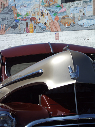 1947 Chevy Fleetline poses in front of the Highland Park Car Show Mural on Figueroa.