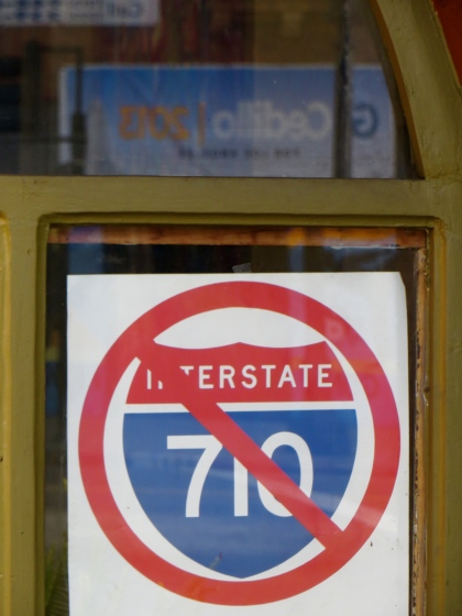 Cedillo Campaign Headquarters reflected against the No on I-710 sign in Folliaro's window.