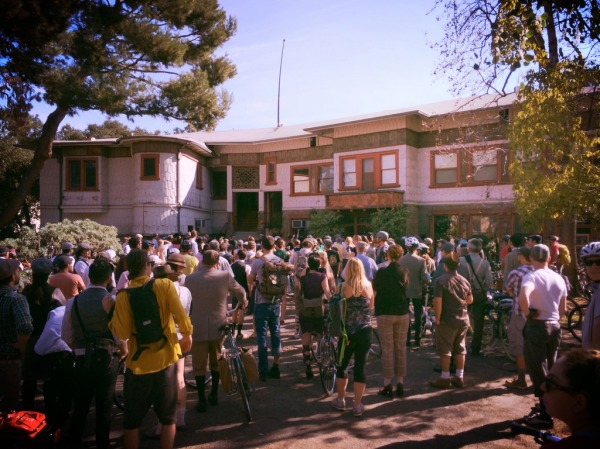 Over 300 cyclists gather outside Judson Studios in Garvanza and try to hear some history on the stained glass studio.