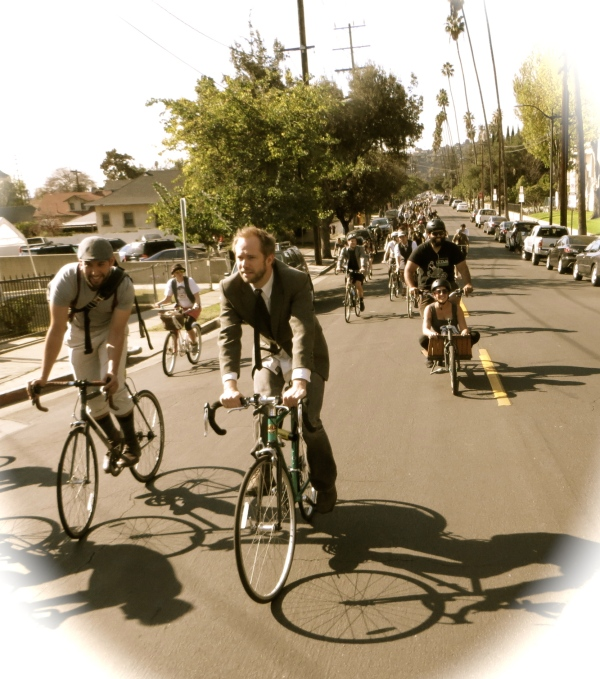 Over 300 dapper cyclists roll up Monte Vista.