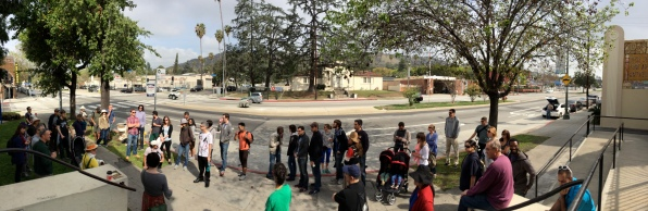 Panarama of walkers across from the 1922 Eagle Rock City Hall.