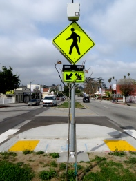 New crosswalk with beg button activated warning beacons.
